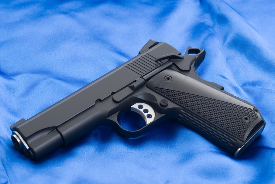 Colt gun m1911 colt gun weapon barrel background cloth 905x606