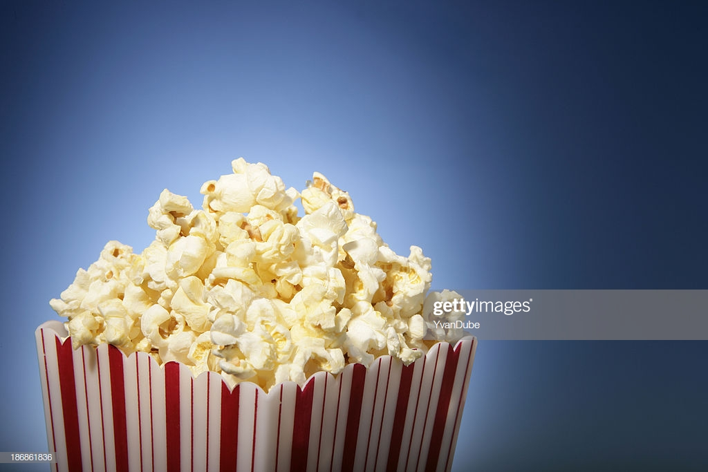 Red Movie Popcorn Box With Blue Background Stock Photo   Getty Images 1024x683
