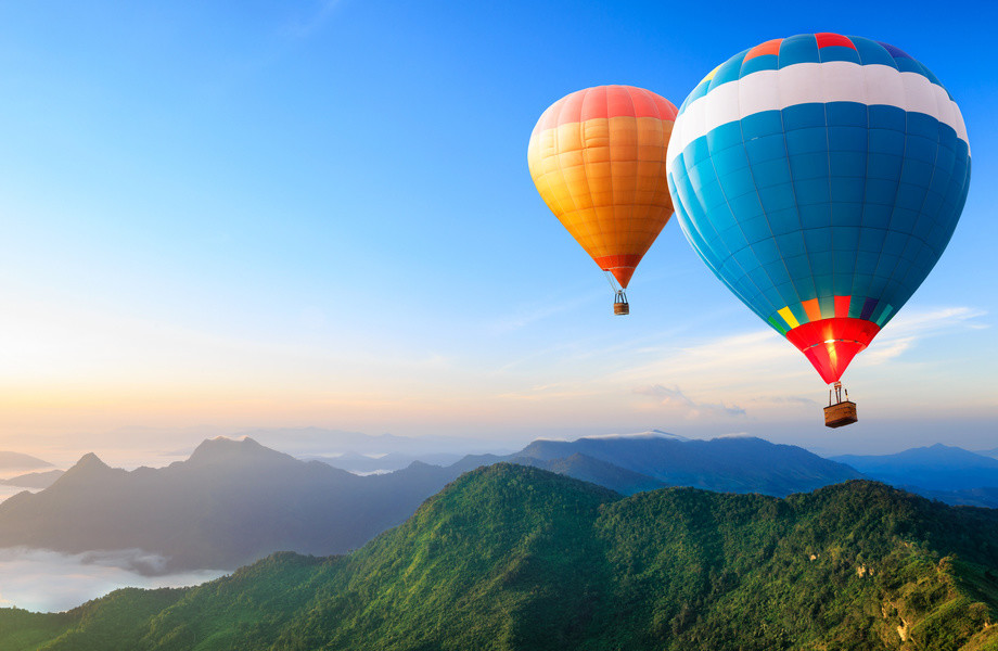 hot air balloons flying over the mountain 4K Ultra HD wallpaper 920x600