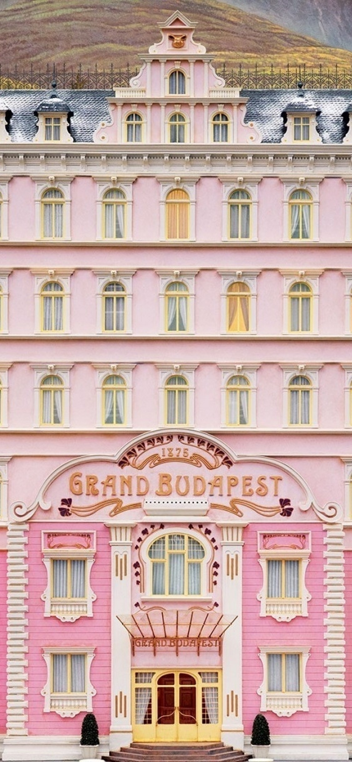 Download 1125x2436 The Grand Budapest Hotel Building Wallpapers 1125x2436
