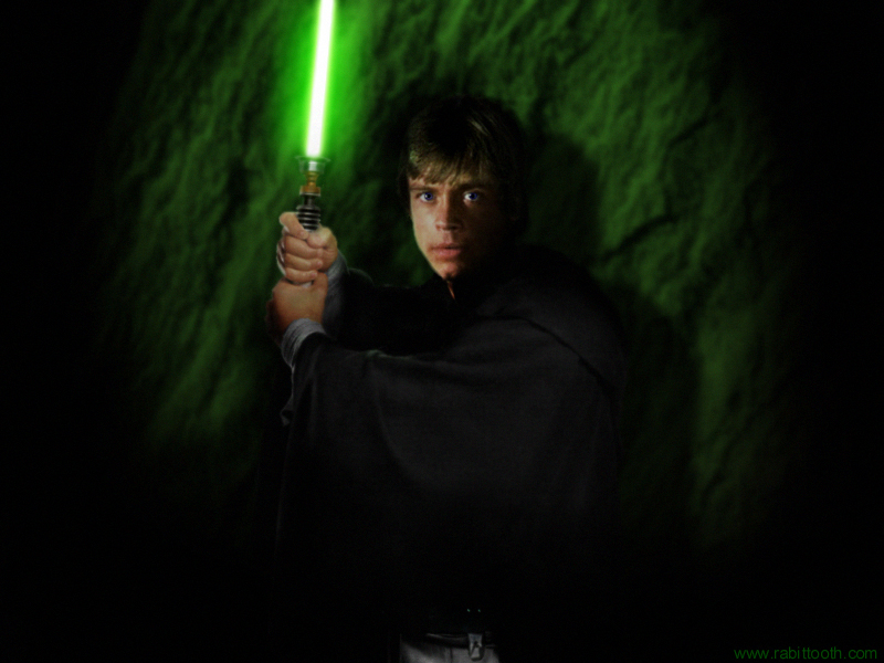 Luke Skywalker wielding his trusty green lightsaber 800x600