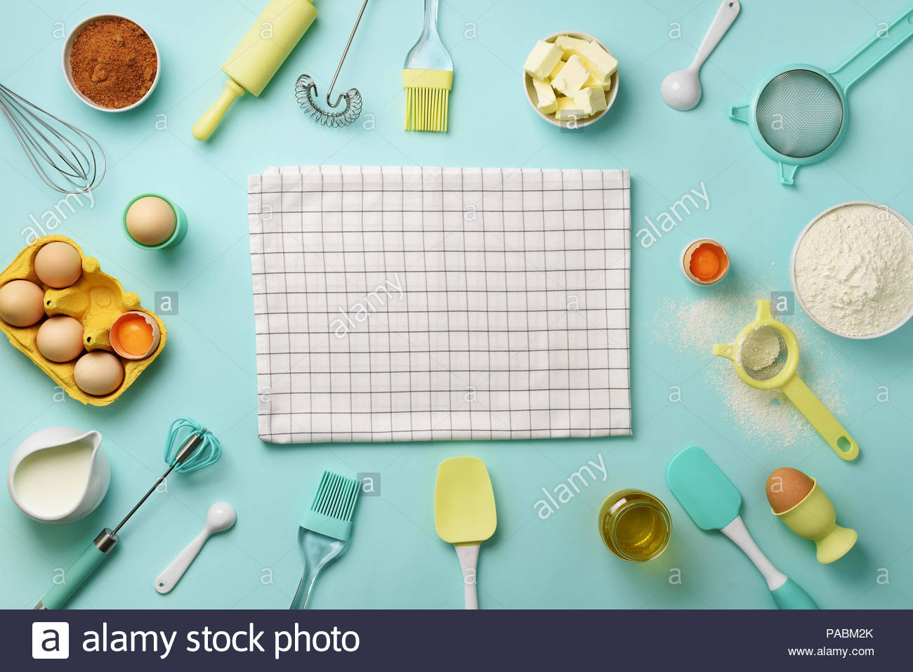 Bakery ingredients over blue background   butter sugar flour 1300x957