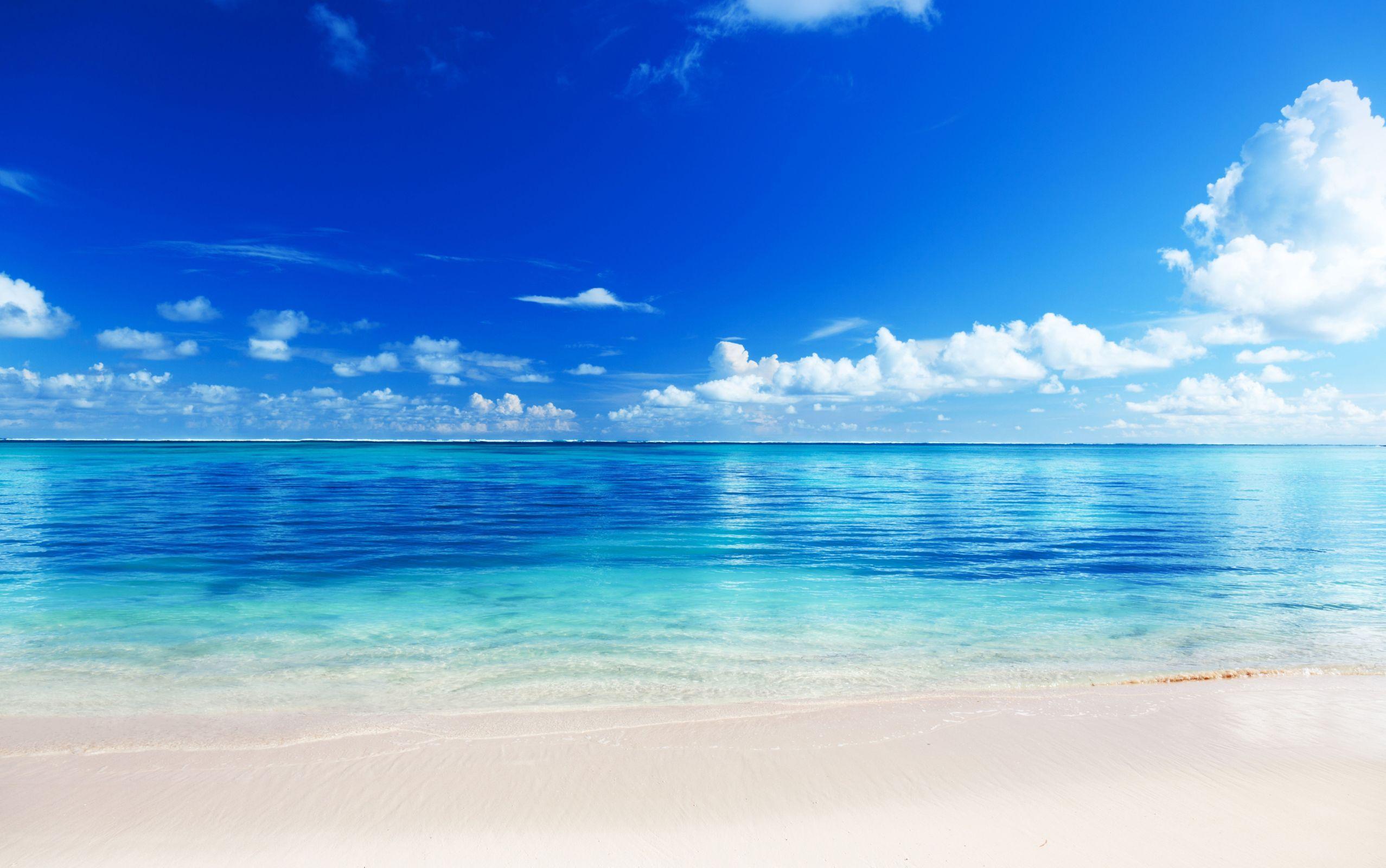 Beach sand ocean horizon sky clouds blue wallpaper 2555x1600