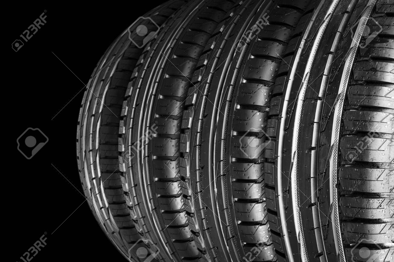 Car Tire Isolated On Black Background Tire Stack Car Tyre 1300x866