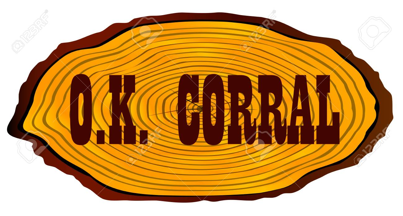 A Section Of A Log With The Words OK Corral Over A White 1300x698