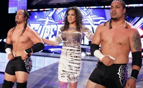 Jey Uso Jimmy Uso and Tamina walking backwards out of the wwe arena 500x308