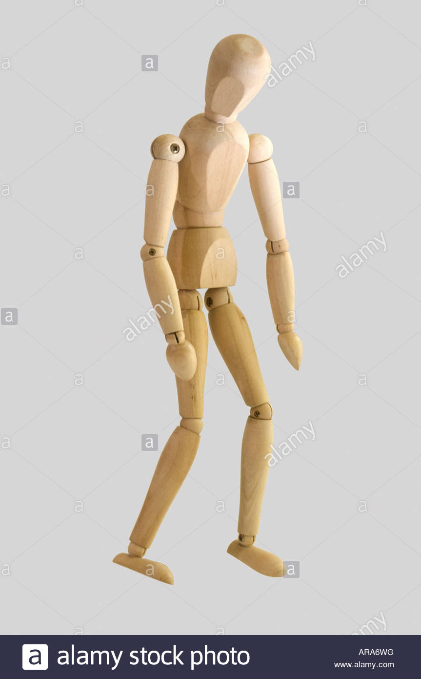 Posed artist manikin on white background depressed posture Stock 863x1390