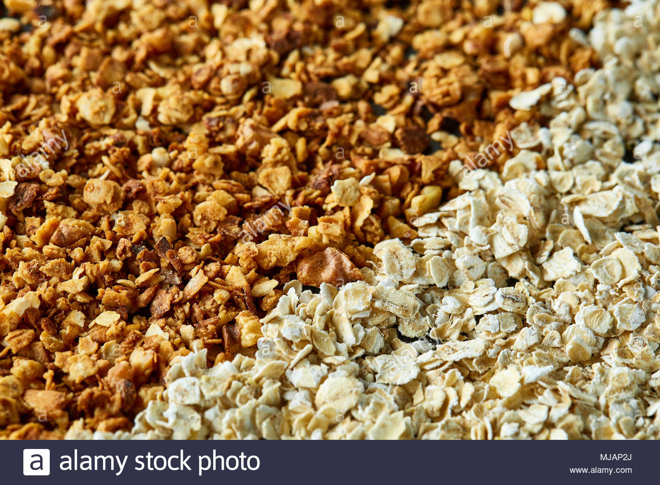 Healthy mix of granola and oatmeal on dark background top view 1300x956