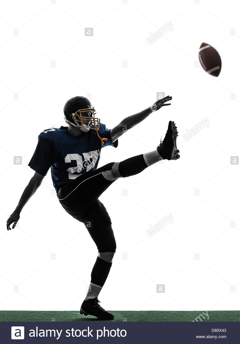 one american football player man kicker kicking in silhouette 971x1390