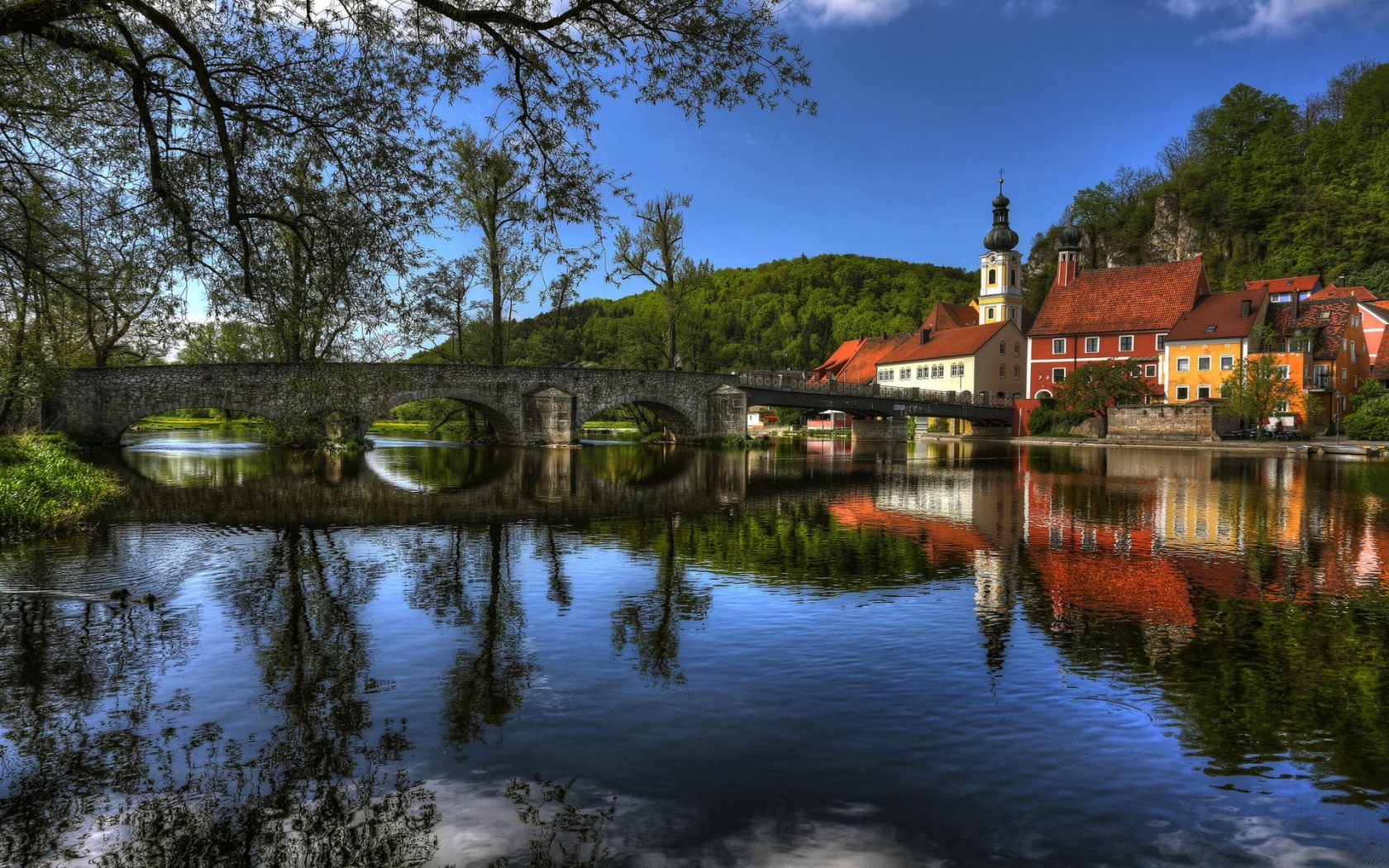 Fantastic bridge in a riverside town Hdr wallpaper 1680x1050