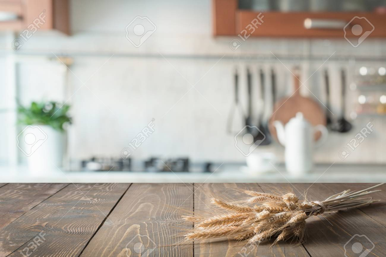 Blurred Background Wooden Tabletop With Wheat On Blur Kitchen 1300x866