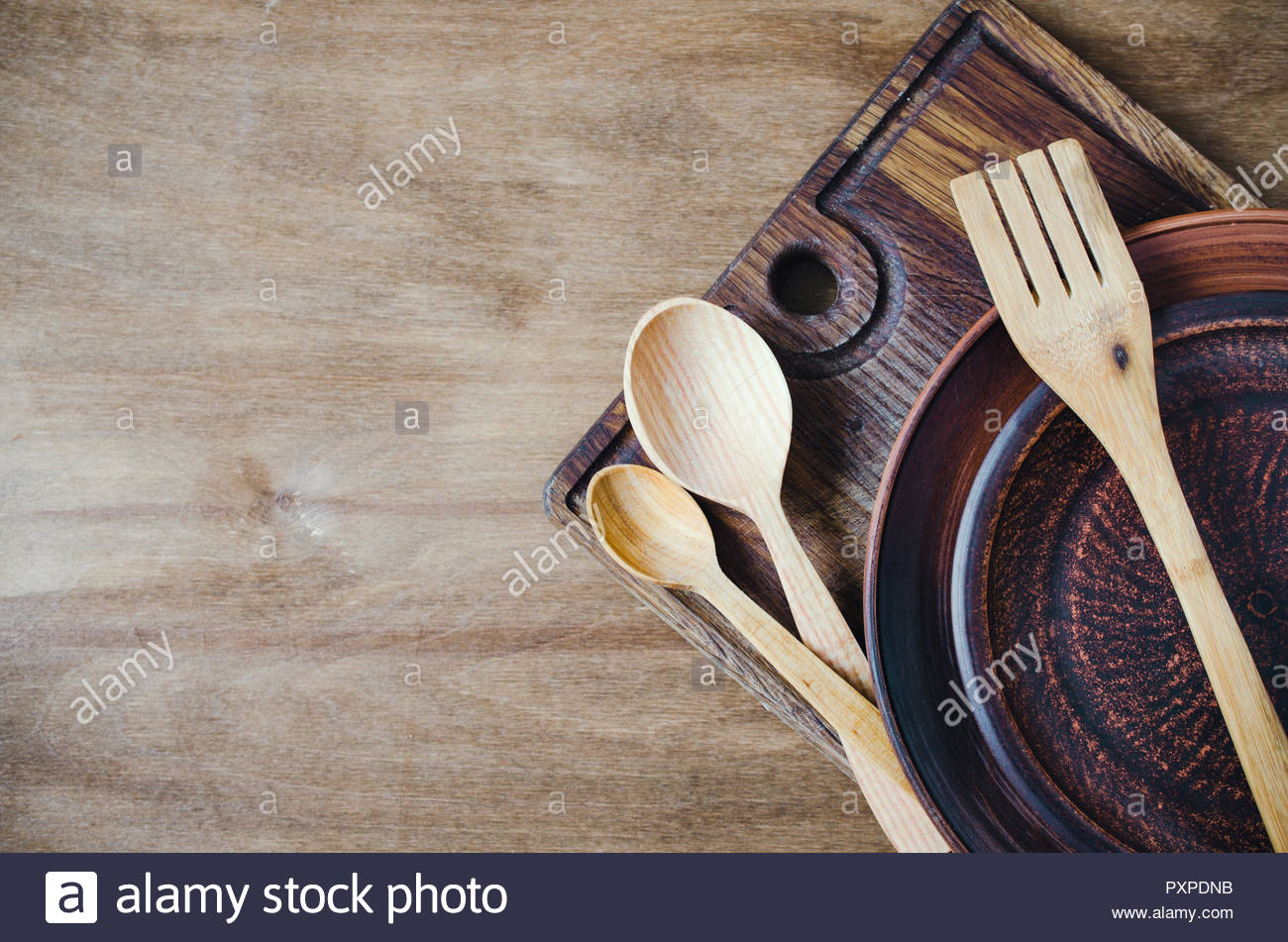 Rustic Kitchen Utensils the Ceramic Plates and Wooden Cutlery on 1300x951