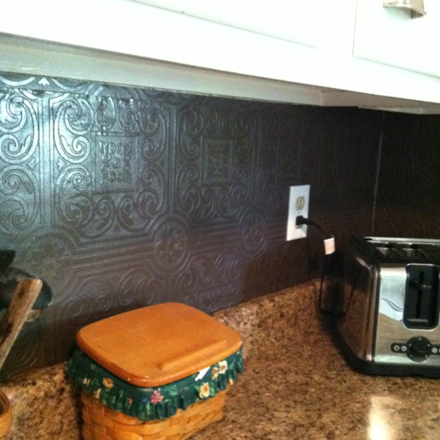 tin wallpaper painted with rubbed bronze spray paint for backsplash 640x640