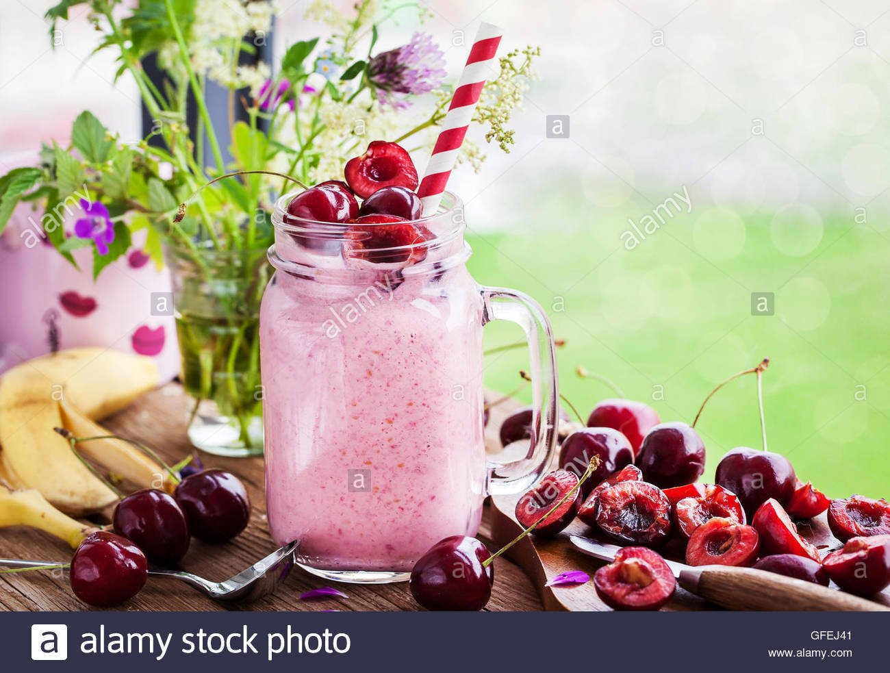 Fresh homemade healthy berry smoothie in mason jar on window Stock 1300x983