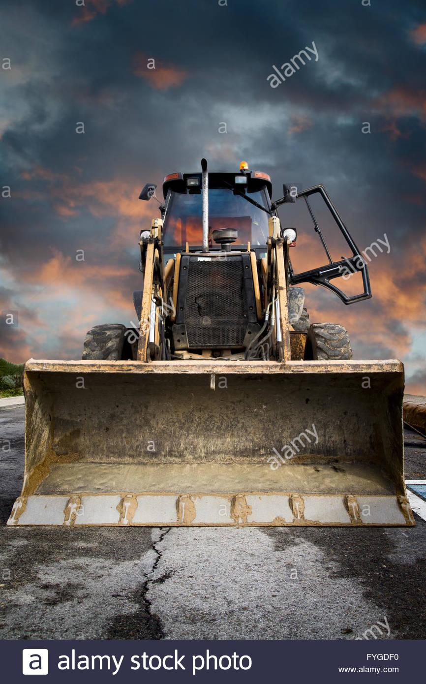 Bulldozer Yellow tractor on dramatic sky background Stock Photo 866x1390