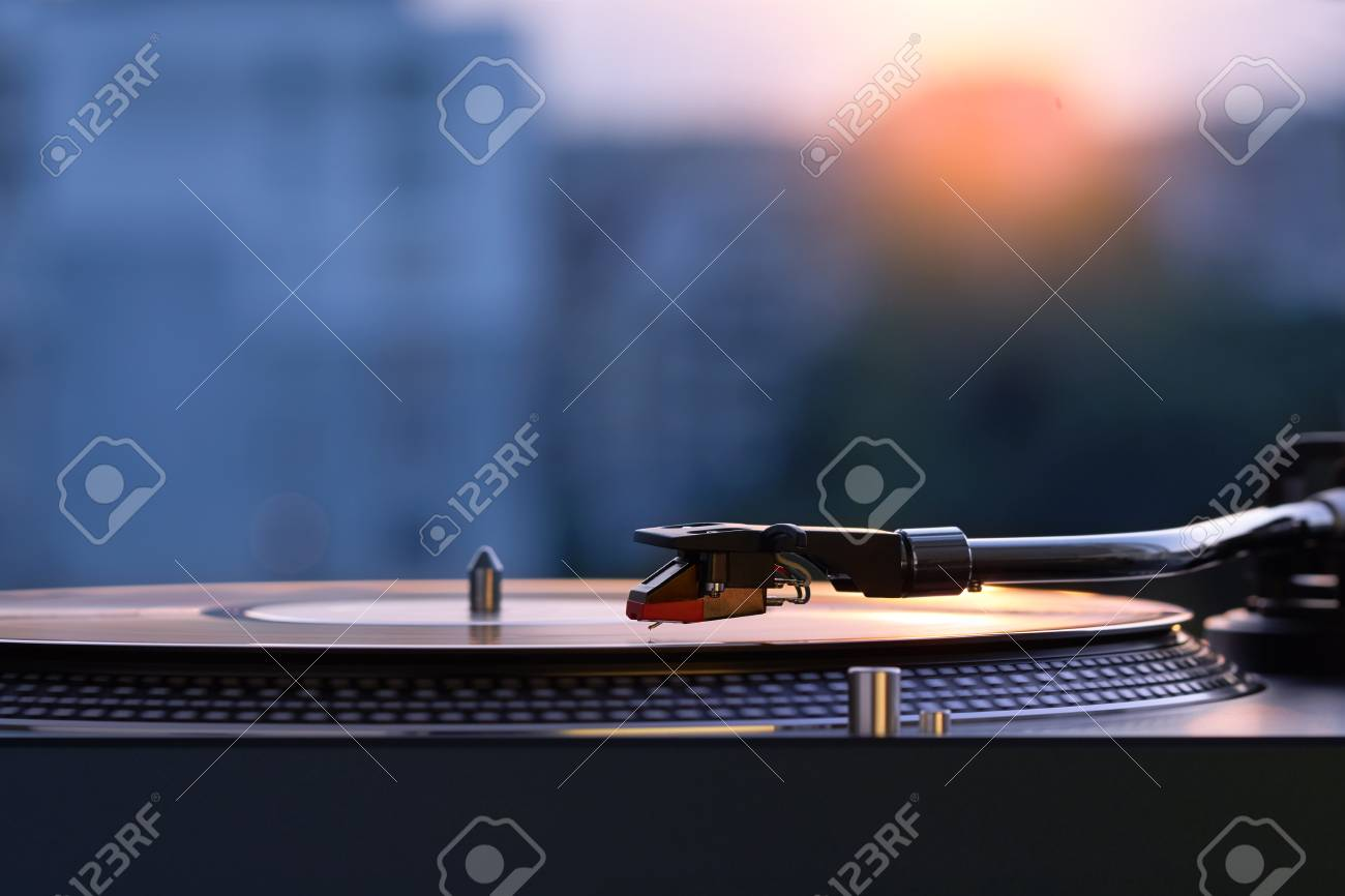 Turntable Vinyl Record Player On The Background Of A Sunset Over 1300x866