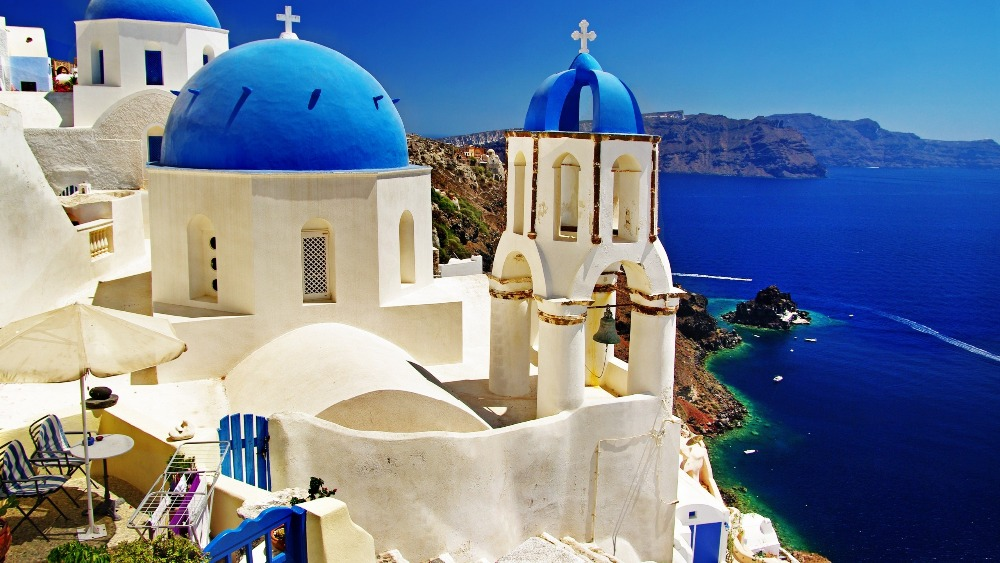 Mediterranean Greece scenery Santorini seaside town Wallpaper Wall 1000x563
