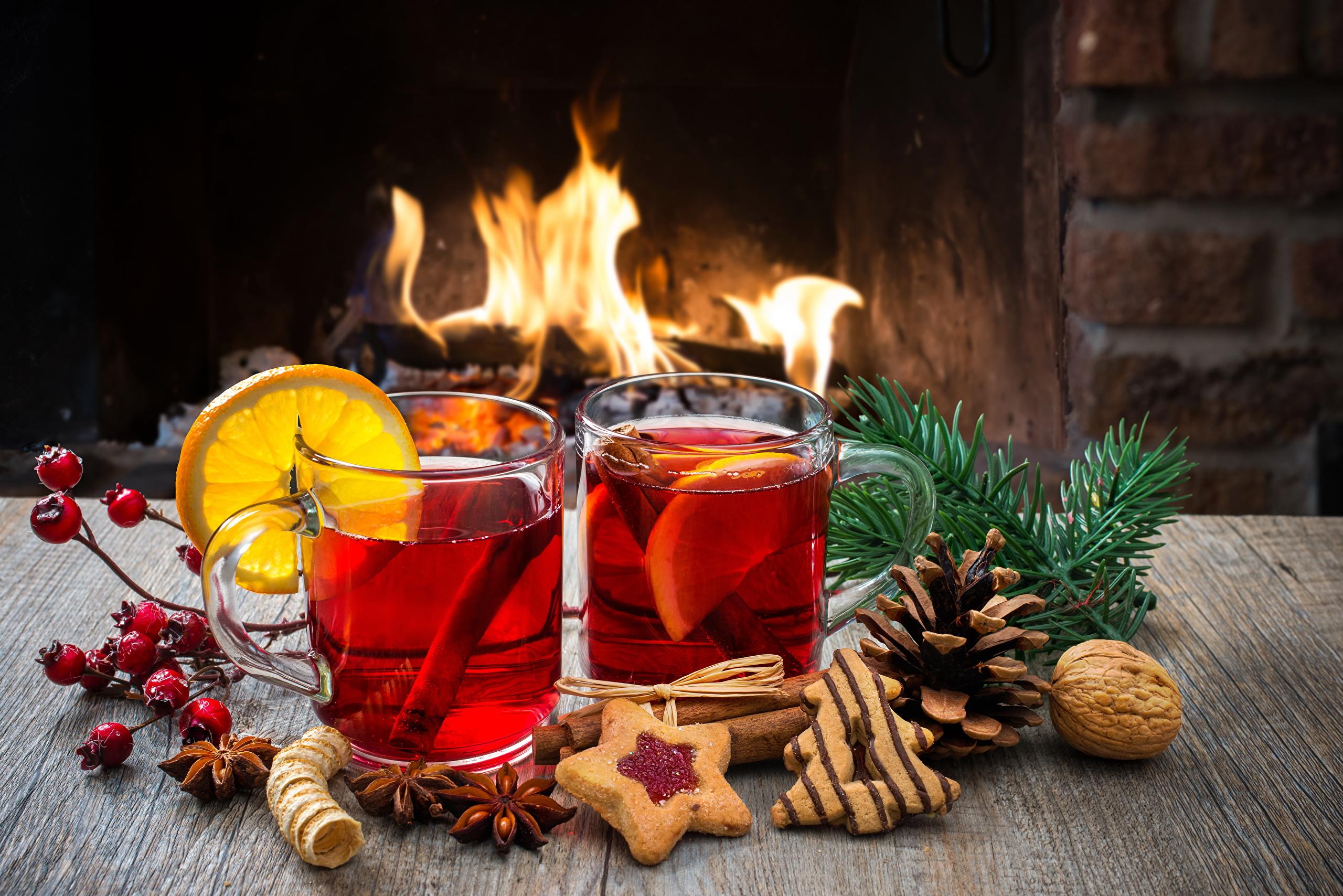 Image Christmas Tea Fire Lemons Highball glass Food 2560x1708