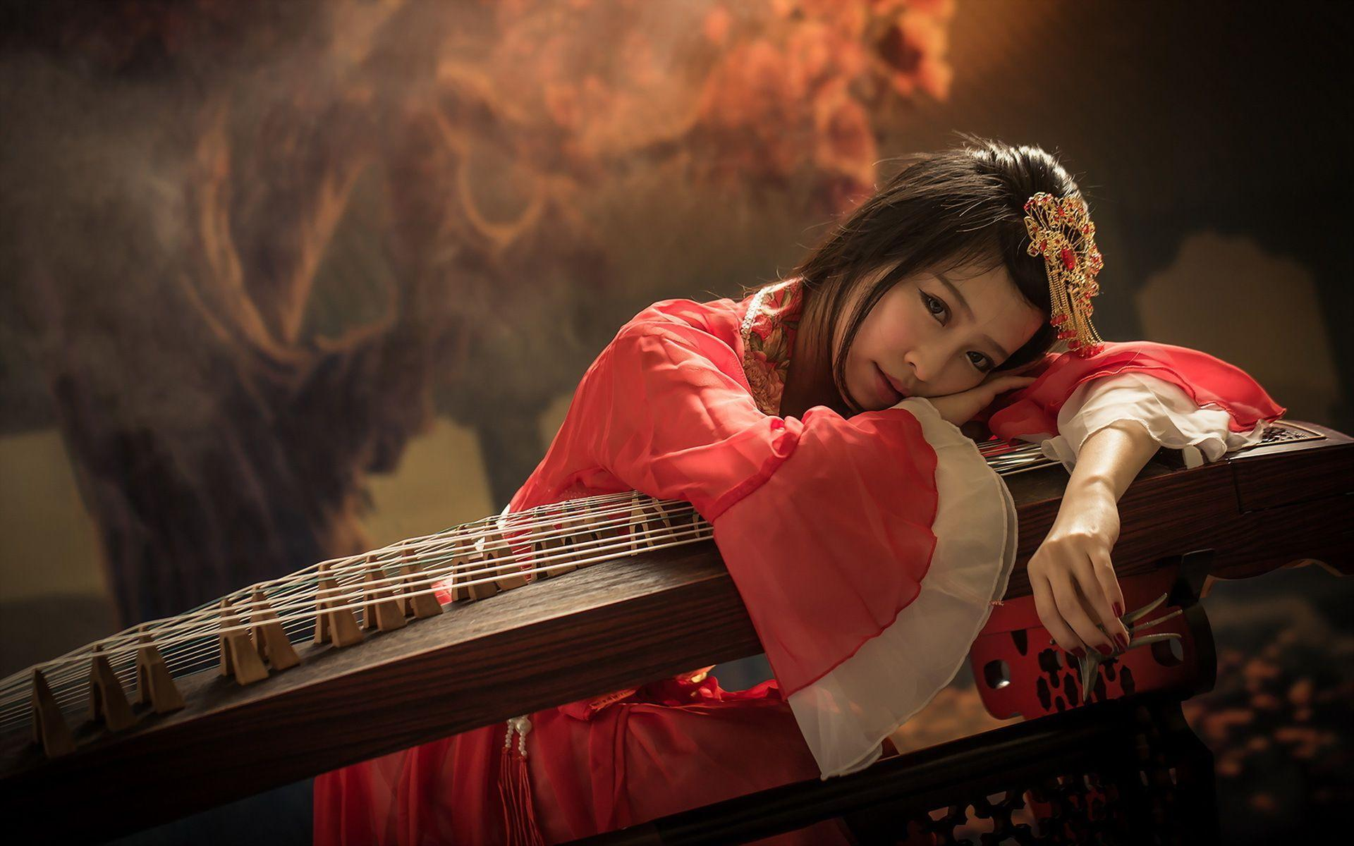 Geisha leaning on the instrument HD desktop wallpaper 1920x1200