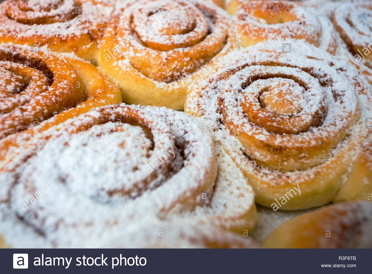 background of delicious fresh buns Cinnabon Stock Photo 225914987 1300x956