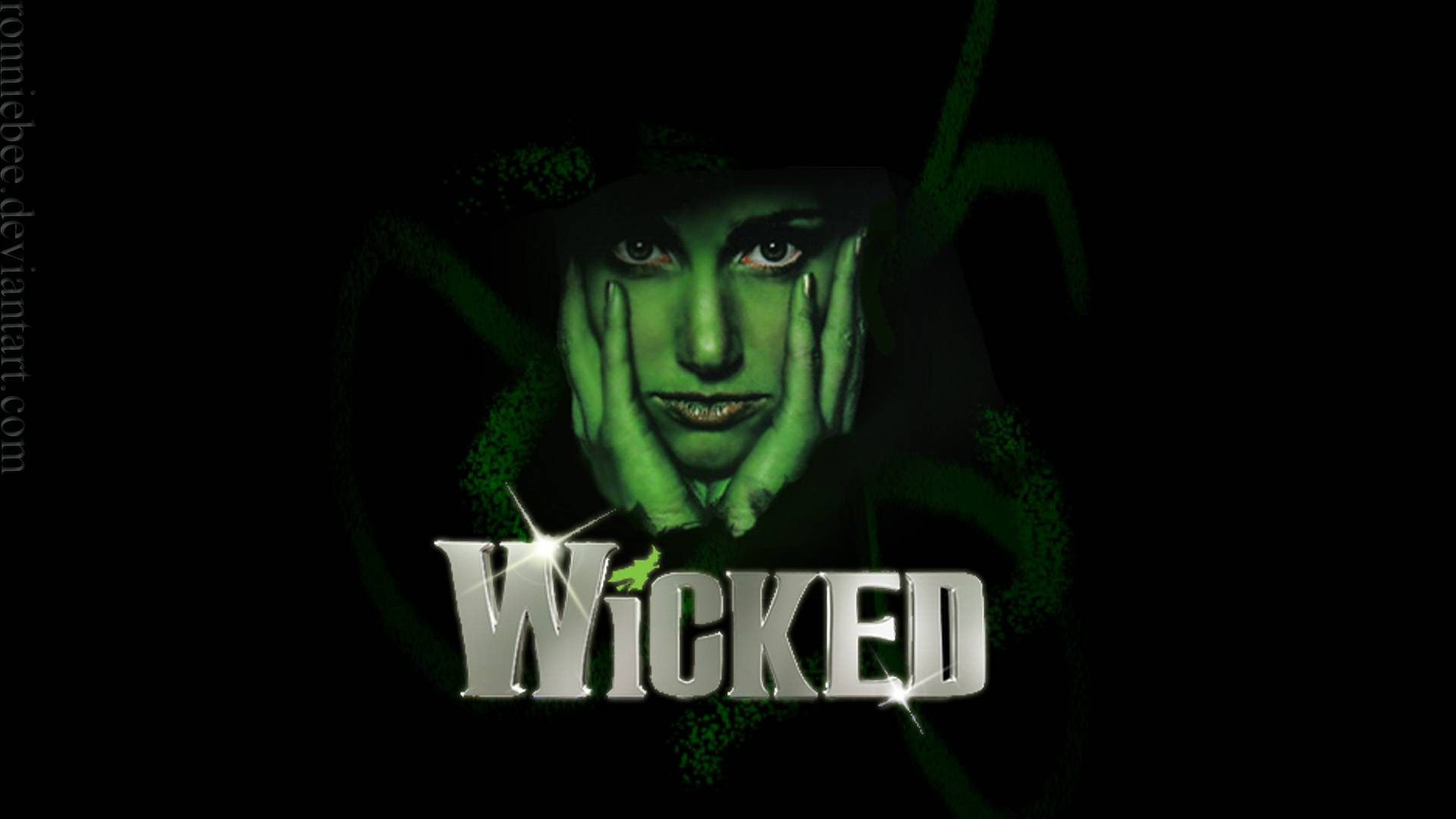 wicked Long before dorothy drops in, two other girls meet in the land of oz one, born with emerald-green skin, is smart, fiery and misunderstood the other is beautiful, ambitious and very popular.