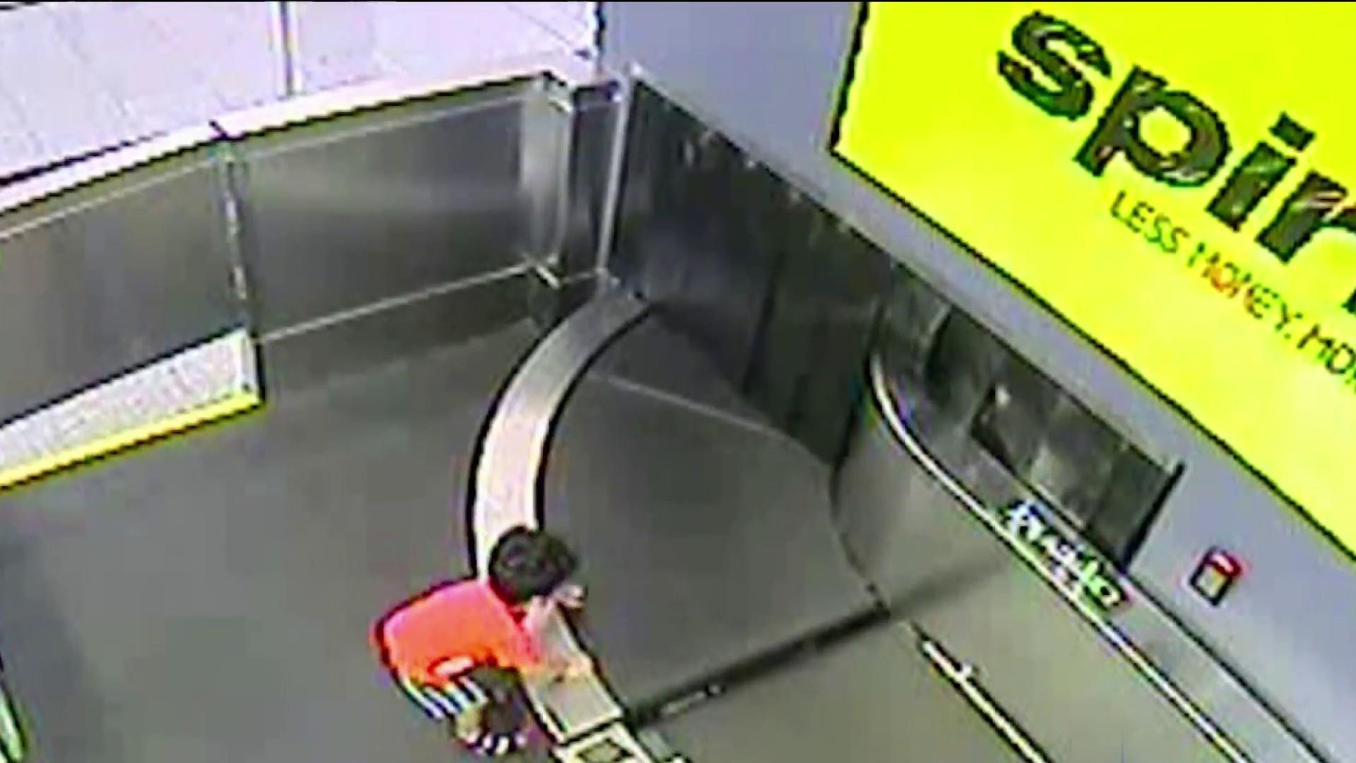 On camera A toddler is swept away on airport conveyor belt 1920x1080