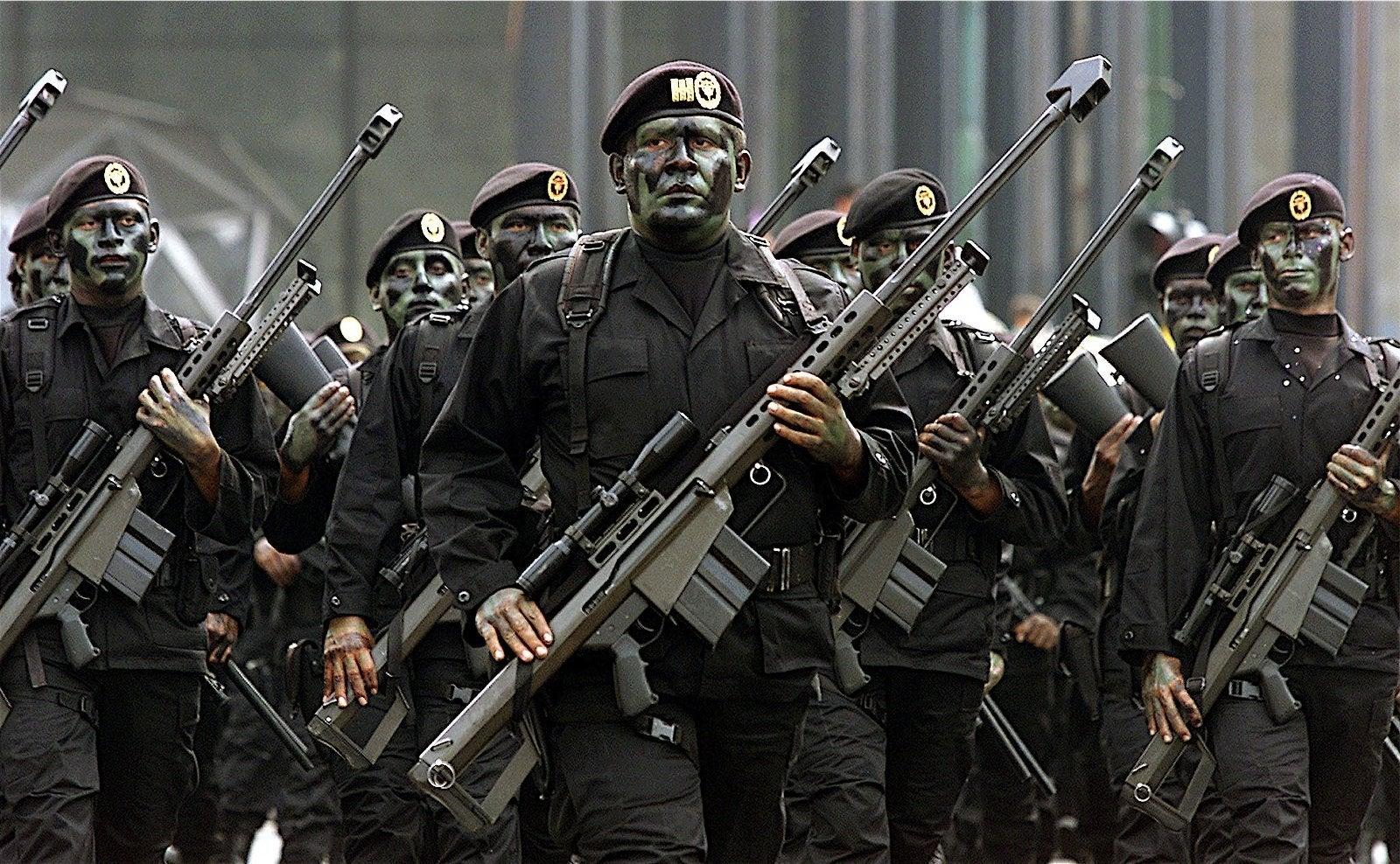 snipers holding Barrett M82 sniper rifles 1600x988 wallpaper 1600x988