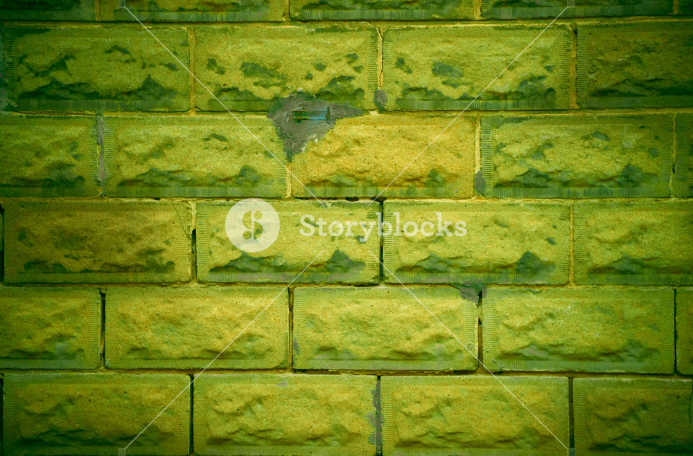 Weathered and rough old lime green wall background Royalty 1000x659