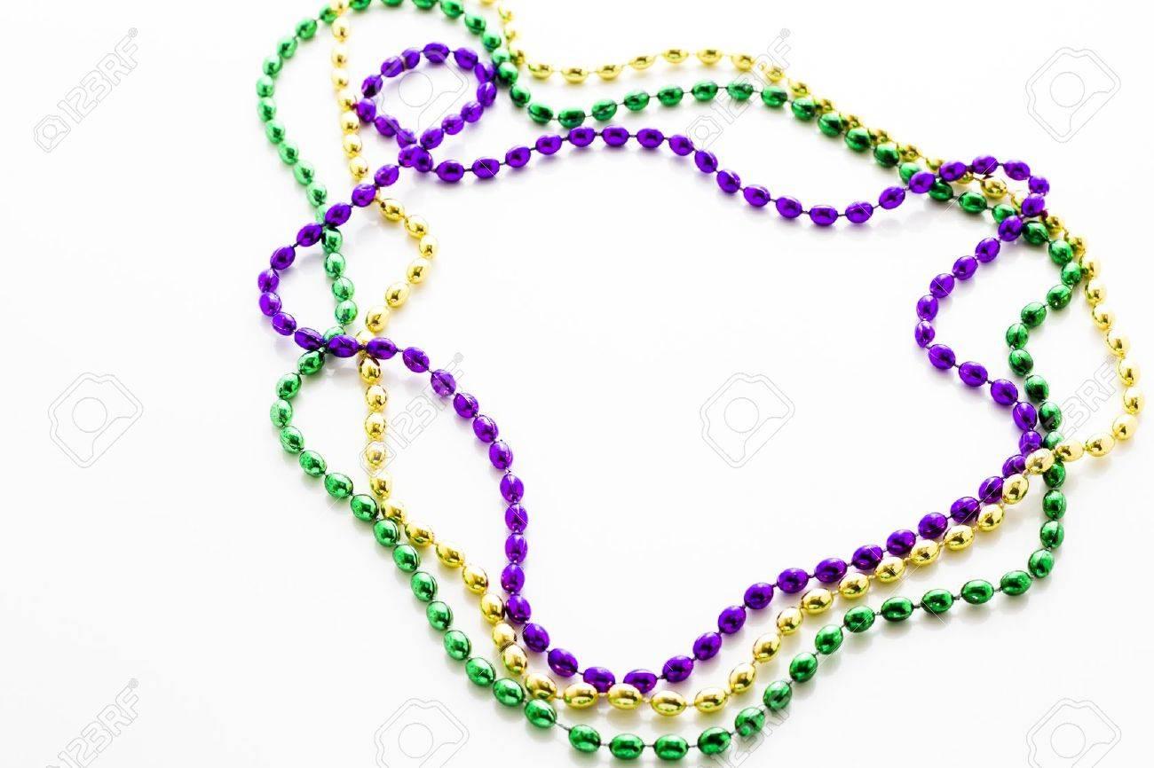 Multi Color Mardi Gras Beads On White Background Stock Photo 1300x866