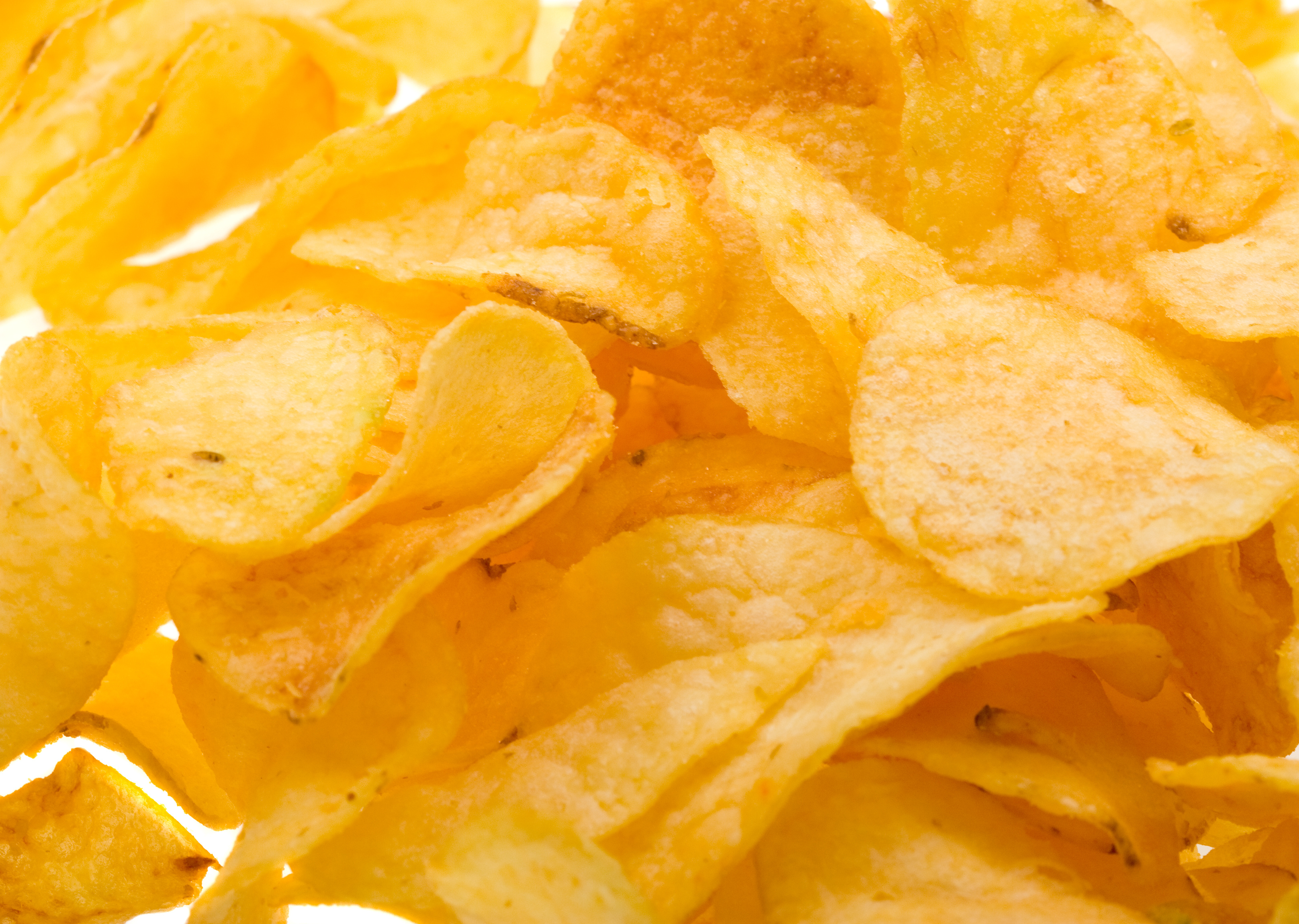 Close up potato chips background 3233x2300