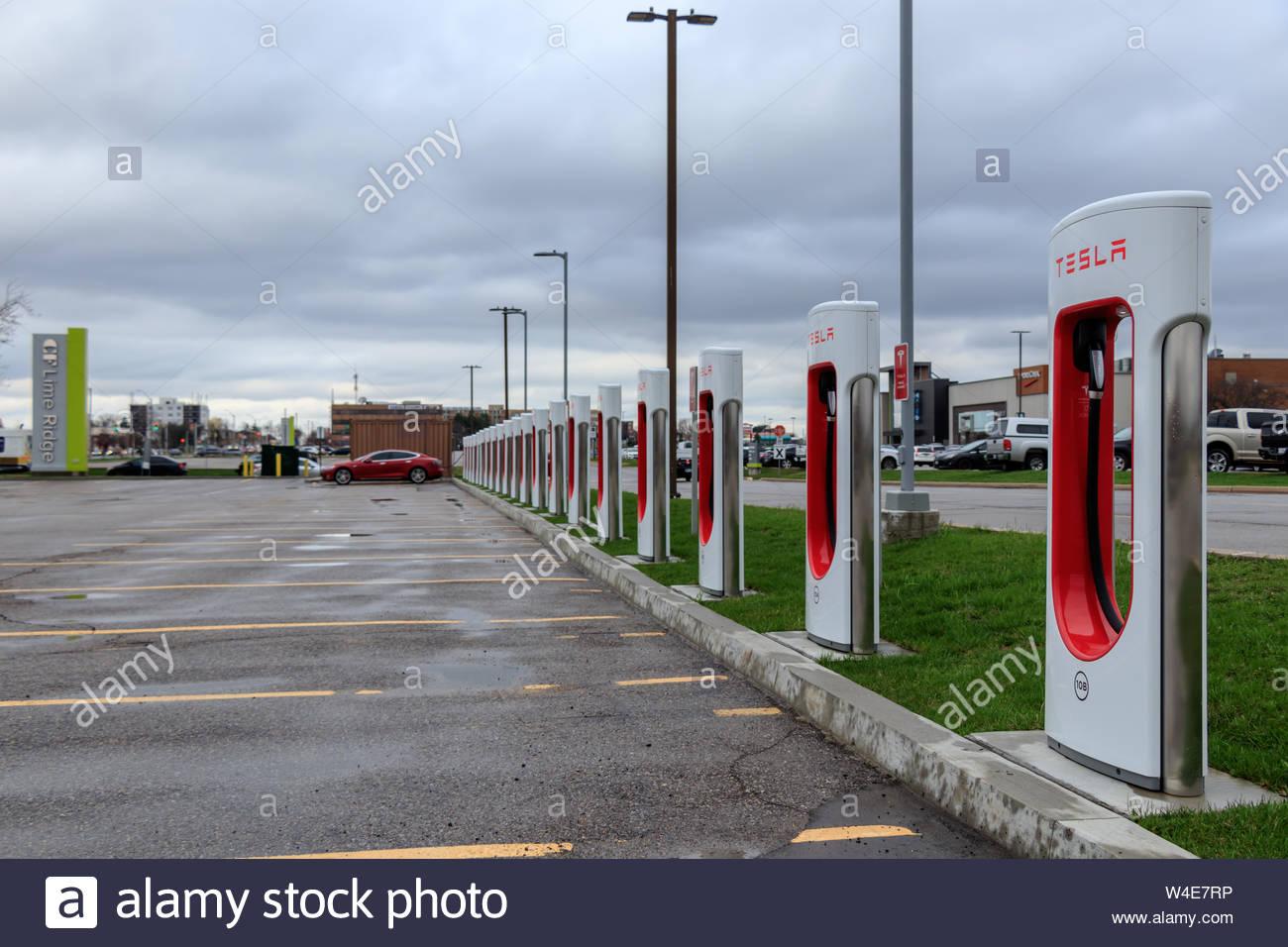 Tesla Supercharger Station with 20 Stalls and Tesla Model S 1300x956