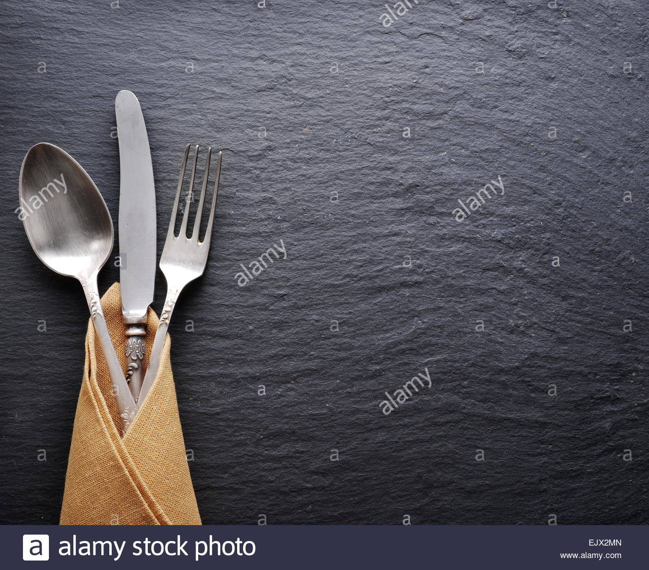 Silver cutlery on a dark gray background Stock Photo 80478181   Alamy 1300x1143