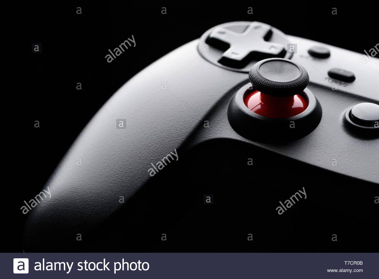 Generic game pad joystick macro closeup on black background Stock 1300x957