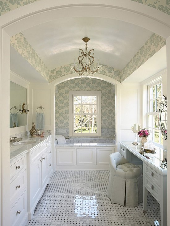 Marble bathroom with mint wallpaper and white cabinetry 550x732