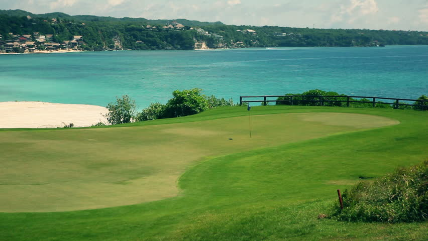 Amazing Golf Course With Flag And Ocean View In The Background Stock 852x480