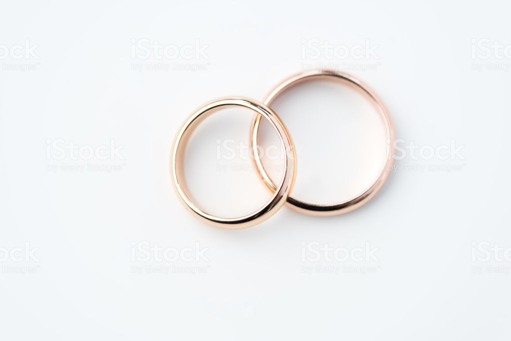 Two Golden Wedding Rings Isolated On White Wedding Rings 1024x683