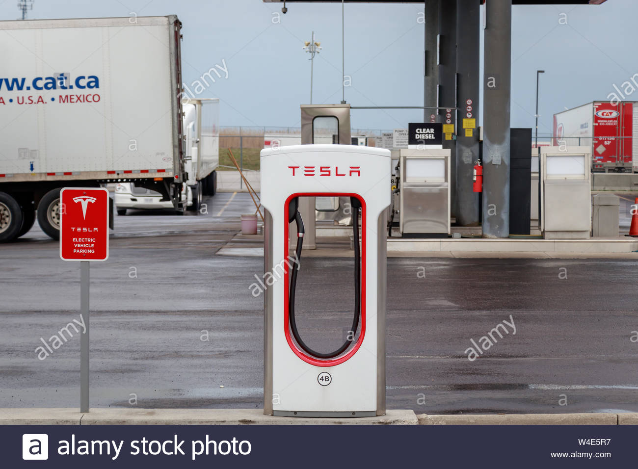Tesla Supercharger Stall with a gas station and truck stop in the 1300x956