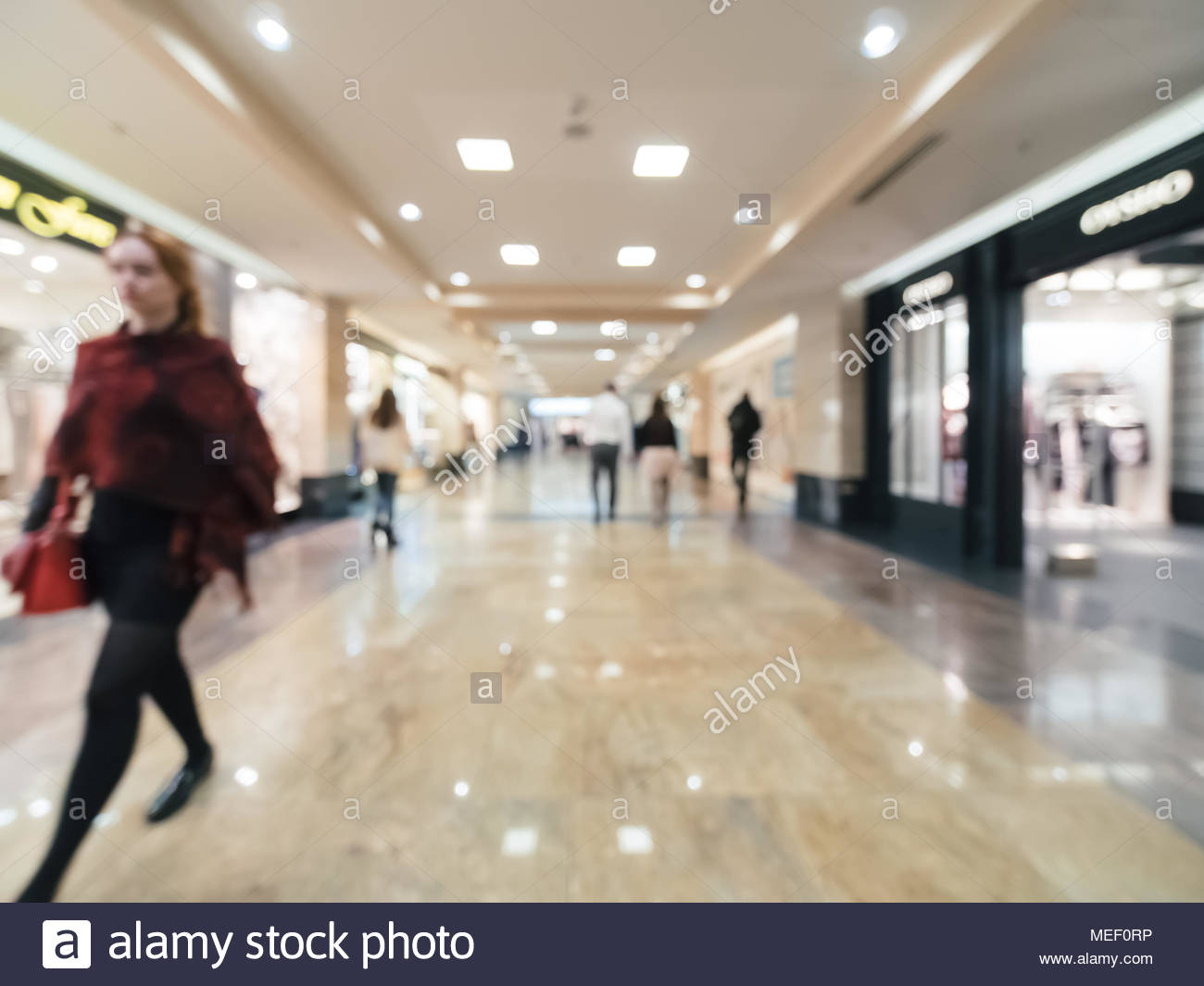 Shopping mall blur background with bokeh Blurred hall of shopping 1300x1065