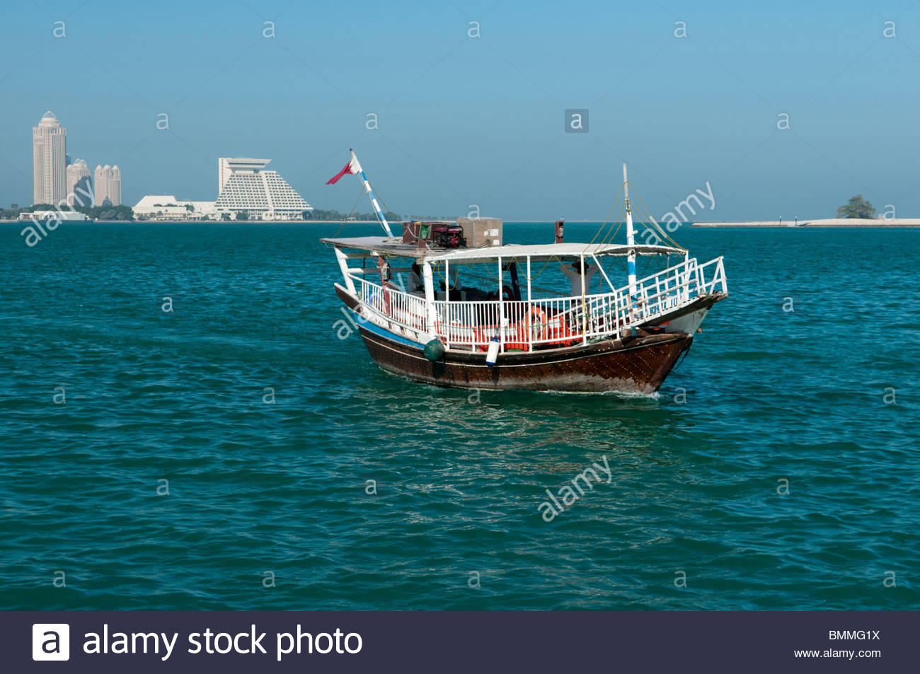 Dhow boat in Doha Qatar with Qtel Tower and Sheraton Hotel in 1300x953