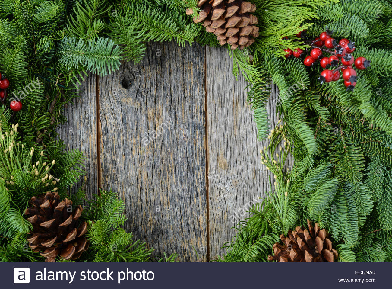 Christmas Wreath with Rustic Wood Background Stock Photo 76519464 1300x957
