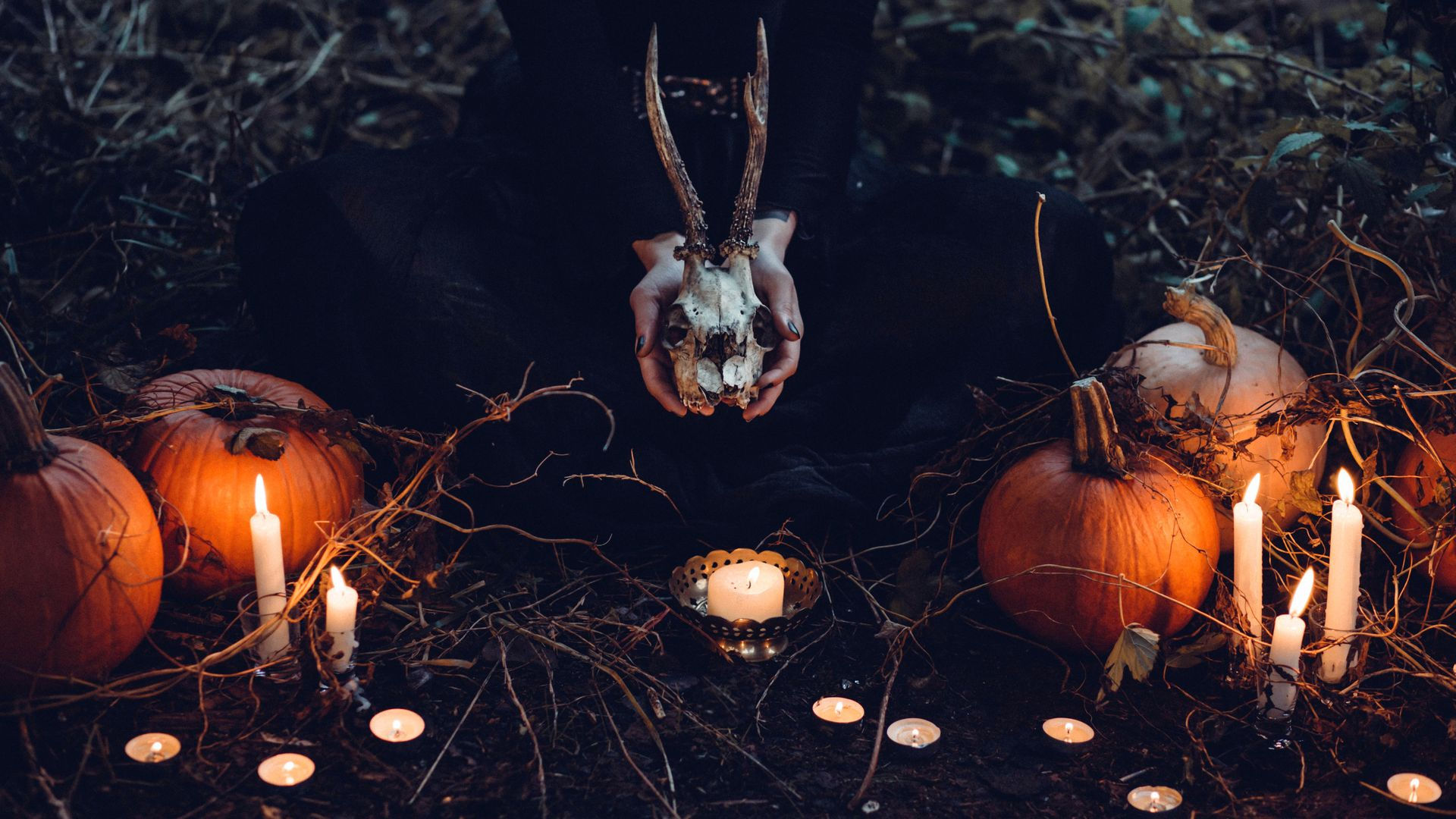 Woman Holding Skull with Horns and Halloween Pumpkins Wallpaper 1920x1080