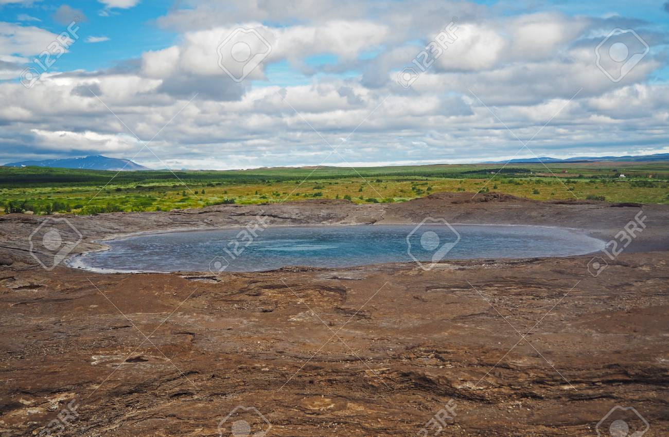 Turquoise Geothermal Geysir Lake In Iceland With Green Grass 1300x850