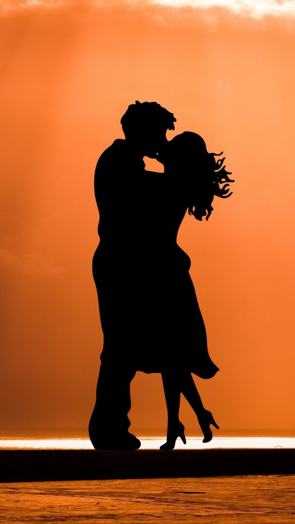 Couple kiss love wallpaper background iphone 576x1024