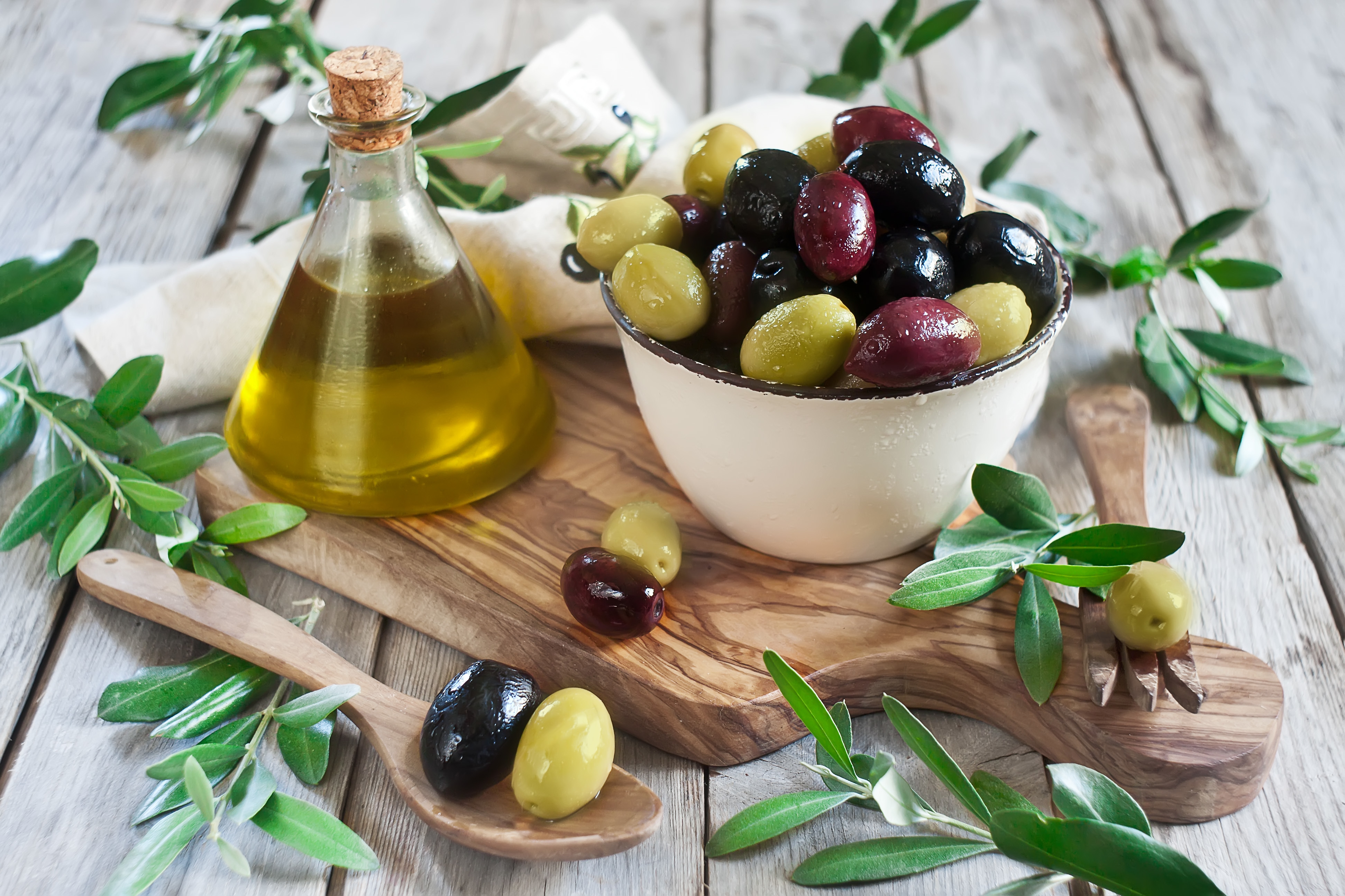 olive oil wooden bowl spoon olives leaves Wallpapers 3888x2592