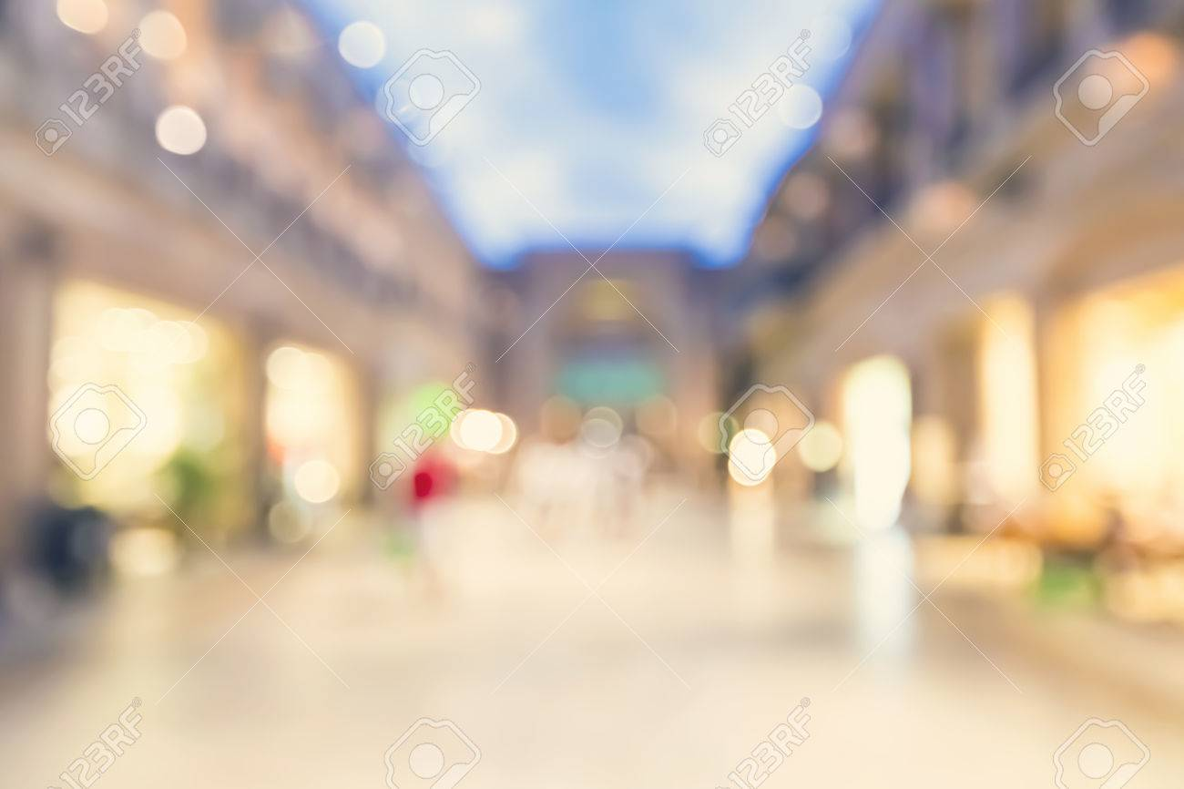 Blurred Illuminated Shopping Mall Background Stock Photo Picture 1300x866