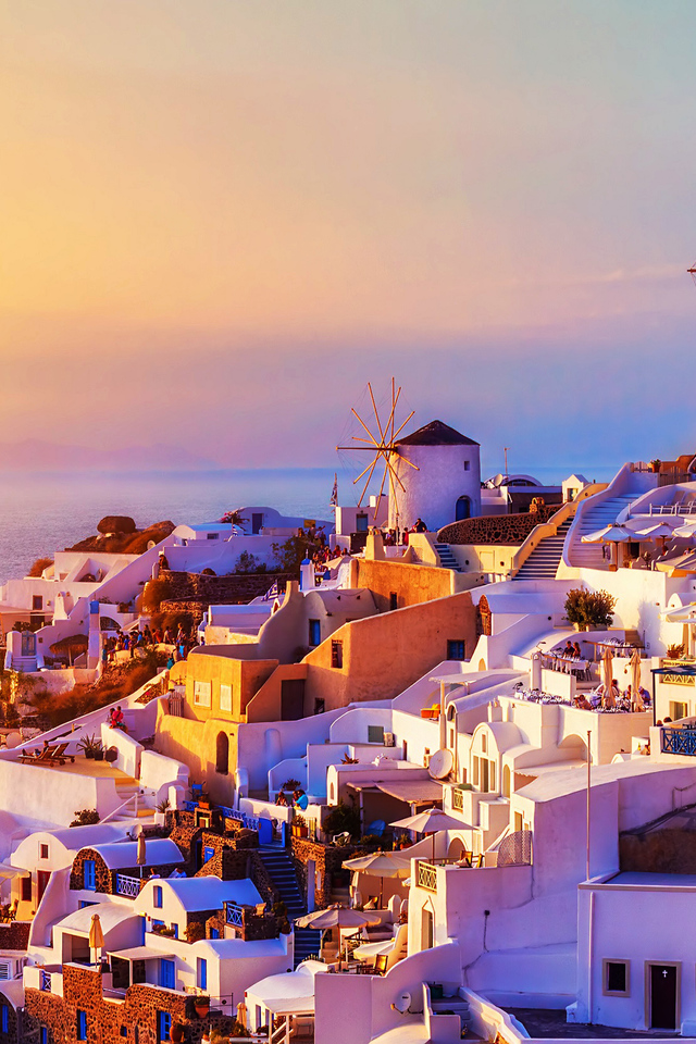 The spectacular sunset over the Oia village in Santorini Greece 640x960