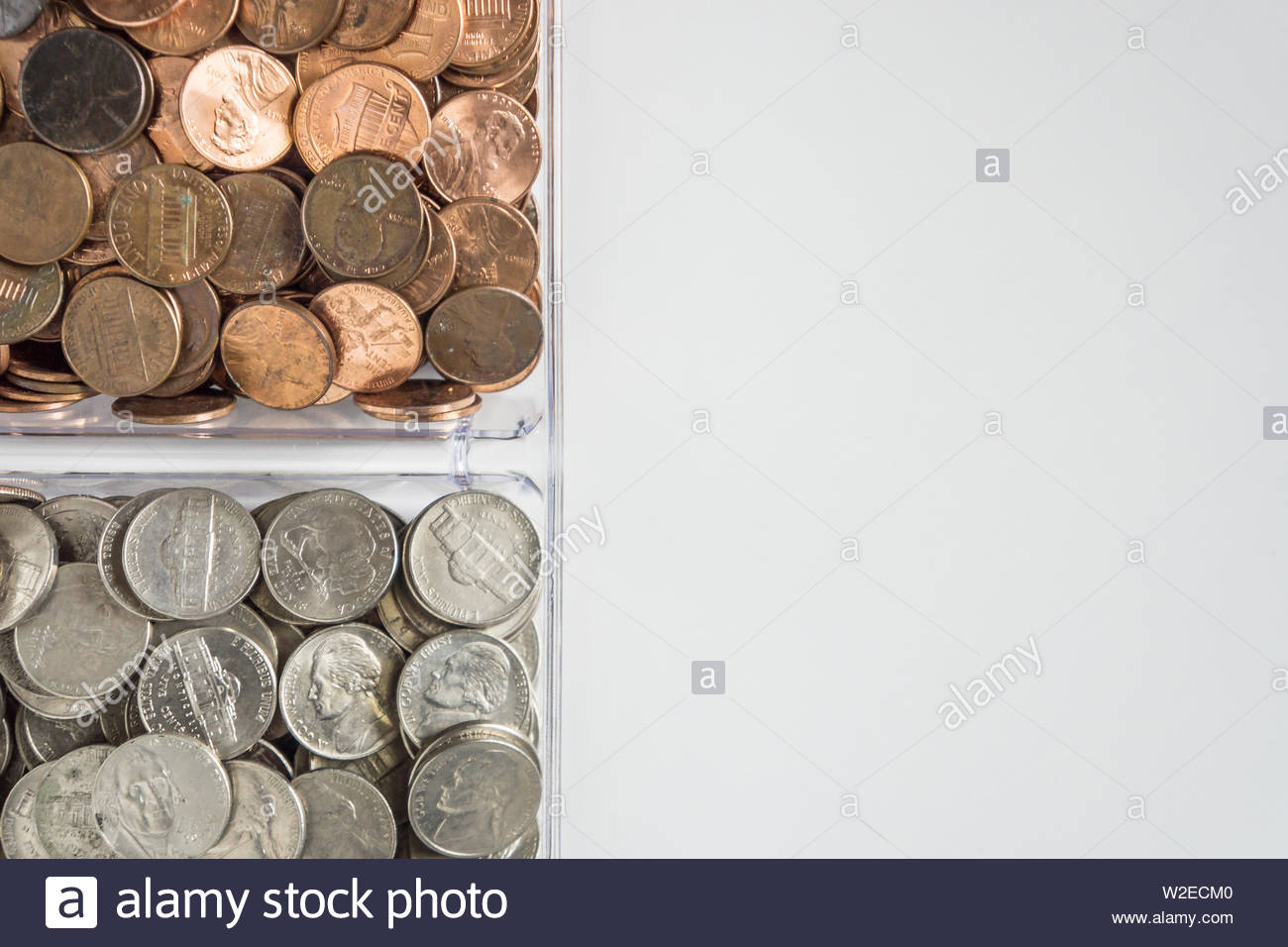 Isolated organized loose coin change on left side white 1300x956