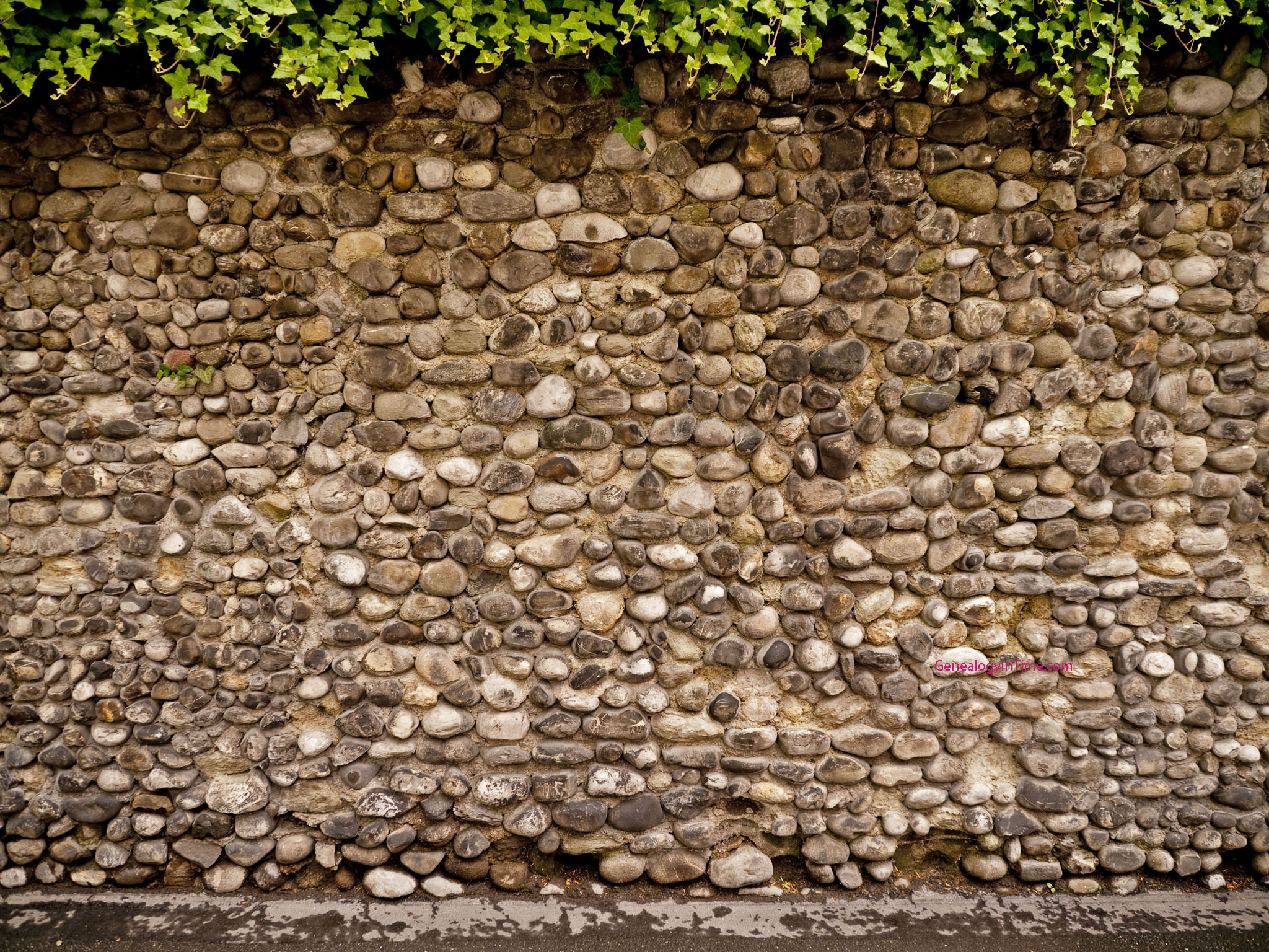 old stone wall made from stream stones 2048x1536