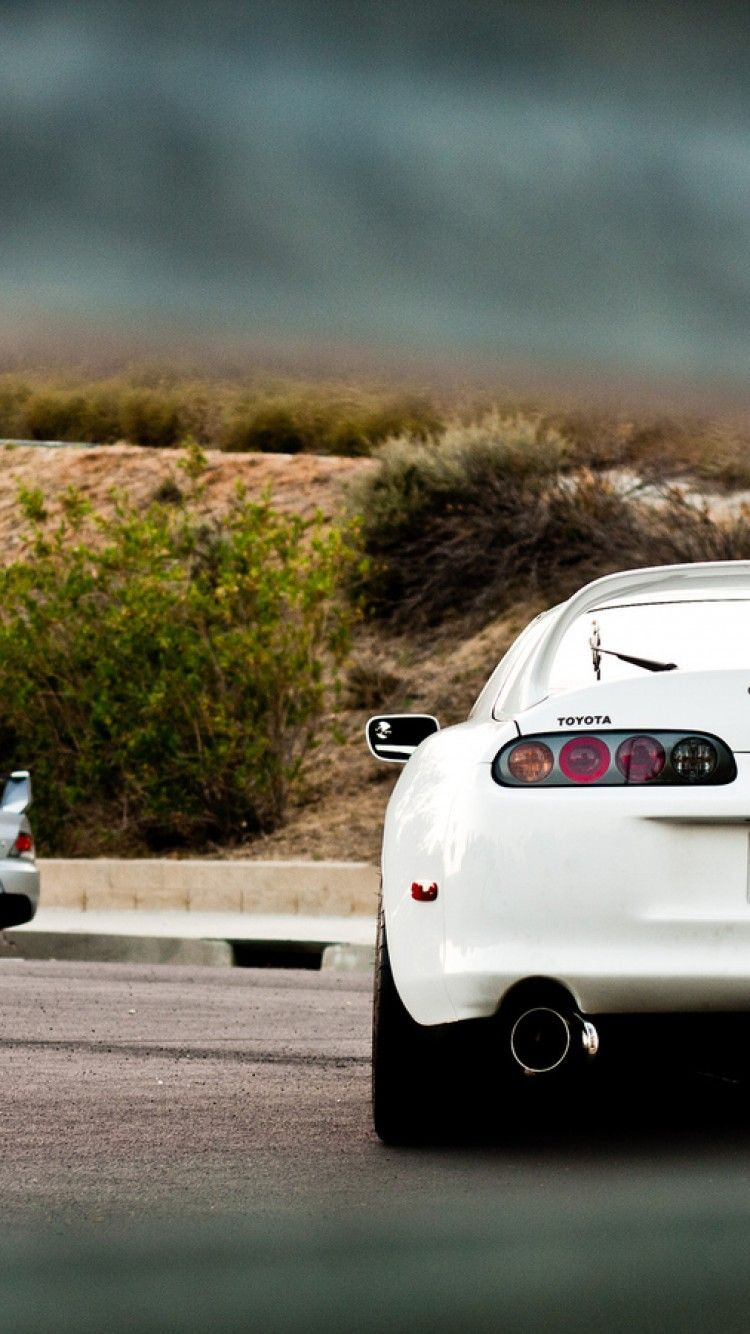 Theres a EVO in the background 3 Toyota Supra 3 Toyota 750x1334