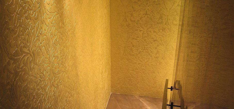 Metallic plaster over paintable wallpaper and venetian stucco 908x424